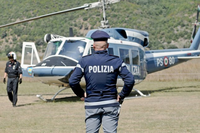 Helicopter of the Italian State Police refueling before takeoff. Photo by Riccardo Arata/Shutterstock