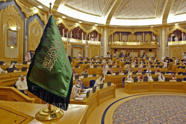 The Saudi flag is seen during a session of the consultative council in Riyadh, Saudi Arabia. Sunday's decree was announced nearly a week after Amnesty International said in its 2019 review Saudi Arabia executed 184 people last year. File Photo by Mike Nelson/EPA