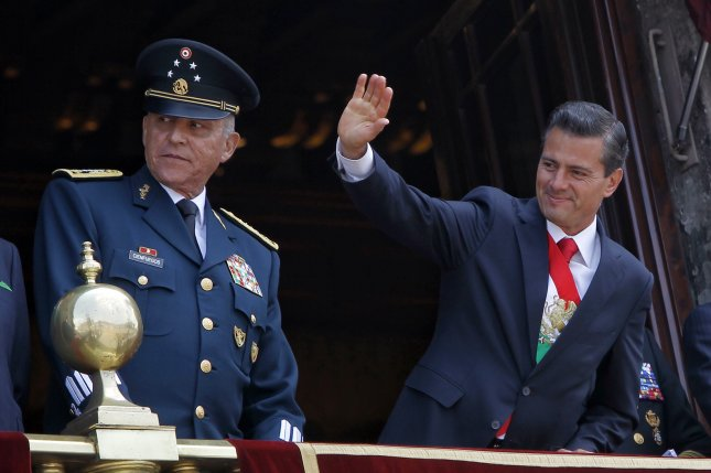 Then-Mexican defense minister Gen. Salvador Cienfuegos appears withPresident Enrique Pena Nieto during a parade celebrating Mexico's Independence in Mexico City Mexico