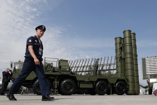 A Russian military official walks in front of an S-400 'Triumph' anti-aircraft missile system outside Moscow, Russia. File Photo by Yuri Kochetkov/EPA-EFE