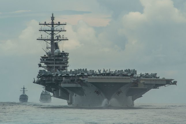 The USS Ronald Reagan, pictured in 2020 with vessels of the Japan Maritime Self-Defense Force, and its carrier strike group on Monday entered the South China Sea. Photo by Mass Communication Specialist 3rd Class James Hong/U.S. Navy