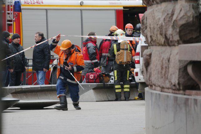 Emergency workers are seen outside Tekhnologichesky Institute metro station after an explosion in Saint Petersburg, Russia, on April 3. Photo by Anatoly Maltsev/EPA