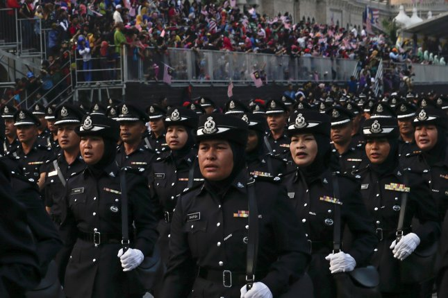 Malaysian Royal Police personnel parade during the Independence Day celebrations in Kuala Lumpur, Malaysia, on August 31, 2015. Police arrested eight men for suspected activities that threatened national security, police said Saturday. Photo by Fazry Ismail/EPA