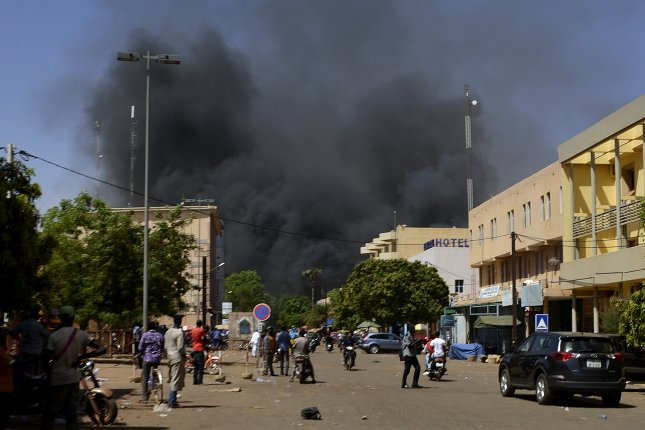 Smoke rises in Ouagadougou, Burkina Faso, following a terrorist attack in 2018. Human Rights Watch accused government forces Monday of killing nearly three dozen unarmed detainees suspected of terrorism. File Photo by EPA-EFE