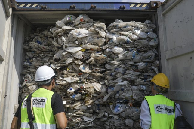 Contaminated plastic waste --from Australia, the United States, Canada, Saudi Arabia, Japan, China, Spain and Bangladesh -- is seen inside cargo containers in Port Klang, Selangor, Malaysia, in 2019, before it is sent back to its country of origin in. Photo by Fazry Ismail/EPA-EFE