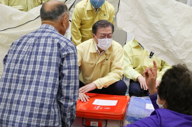 South Korean President Moon Jae-in (C) meets with evacuated residents at a shelter in a village in Paju, South Korea, on Thursday. Photo by Yonhap/EPA-EFE