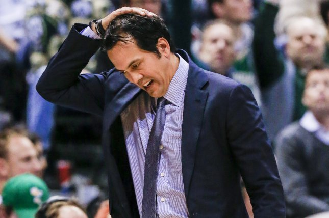6762c8c7b Miami Heat head coach Erik Spoelstra reacts to his team s play against the  Milwaukee Bucks in the first half of their NBA game at the BMO Harris  Bradley ...