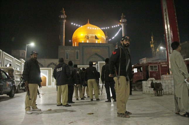 Pakistani security officials guard the shrine of Sufi Muslim saint Lal Shahbaz Qalandar after a suicide bomb attack in the rural town of Sehwan, Pakistan, on Thursday. At least 80 people were killed and more than 250 were injured in the incident. In a following security crackdown, Pakistani officials said forces killed at least 39 suspected militants. Photo by Nadeem Khawer/EPA