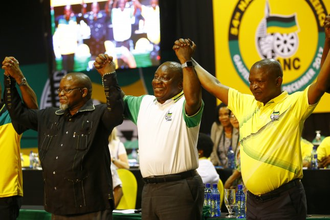 New African National Congress President Cyril Ramaphosa (C) celebrates on stage after winning the presidential race during the 54th ANC National Conference held at the NASREC Convention Centre in Johannesburg, South Africa, on Monday. Photo by Kim Ludbrook/EPA-EFE