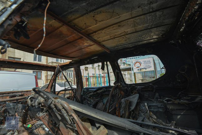 A photo made available by the Armenian Foreign Ministry shows a car damaged after fighting in Stepanakert of the disputed Nagorno-Karabakh region on Tuesday. Photo by Armenian Foreign Ministry/EPA-EFE