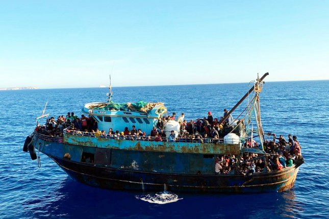One of the two boats with a total of 415 migrants board is shown in Lampedusa, Italy, in May. Another such boat sank off the coast of Tunisia Saturday, killing more than 40 passengers. File photo by Ansa/EPA-EFE