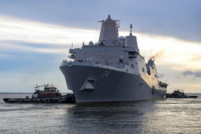 The amphibious transport dock ship USS Arlington departs Naval Station Norfolk to help support humanitarian assistance and disaster relief efforts in Haiti after its a 7.2-magnitude earthquake on Saturday. Photo by Mass Communication Specialist 1st Class Jacob Milham/U.S. Navy