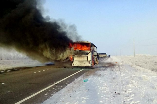 A passenger bus burning on a road in the Irgiz district of the Aktobe region in Kazakhstan. Photo by Kazakhstan's Internal Affairs Ministry/EPA