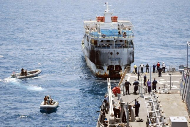 The Guided-missile destroyer USS Stout tows Tanzanian-flagged passenger ferry Spice Island on September 26, 2007, while in international waters off the coast of Somalia. The ferry sank September 10, 2011. File Photo courtesy of the U.S. Navy