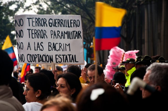 People line the streets of Bogota, Colombia to protest against the FARC in 2011. Photo by Jess Kraft/Shutterstock