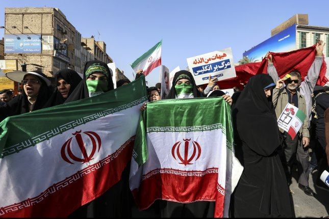 Iranian women hold Iran national flags as they take part in a stat organized rally against anti-government protests in Ahvaz, southwest Iran, on Wednesday. Photo by Morteza Jaberian/EPA-EFE