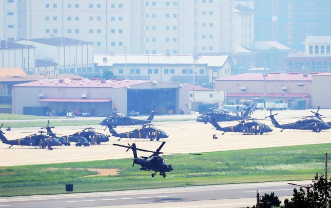 An Apache chopper takes off at U.S. base Camp Humphreys in Pyeongtaek, 43 miles south of Seoul, on Monday, as South Korea and the United States kicked off their joint military exercise. Photo by Yonhap