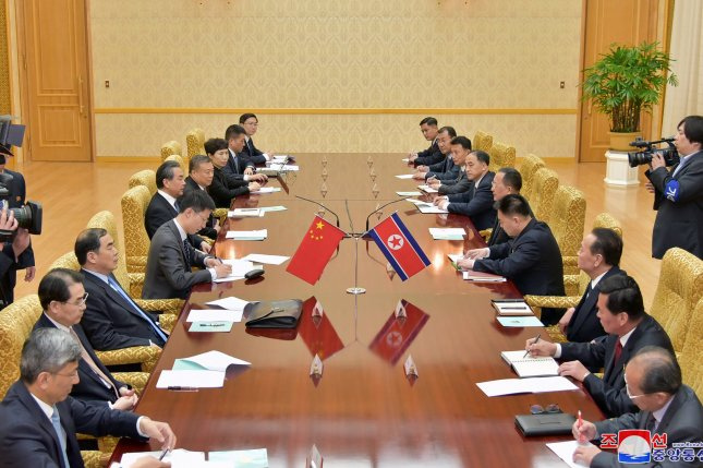 Ri Yong Ho, foreign minister of North Korea, and Wang Yi, state councilor and foreign minister of the People's Republic of China holding a meeting at the Mansudae Assembly Hall in Pyongyang, North Korea, Wednesday. Photo by KCNA/EPA-EFE