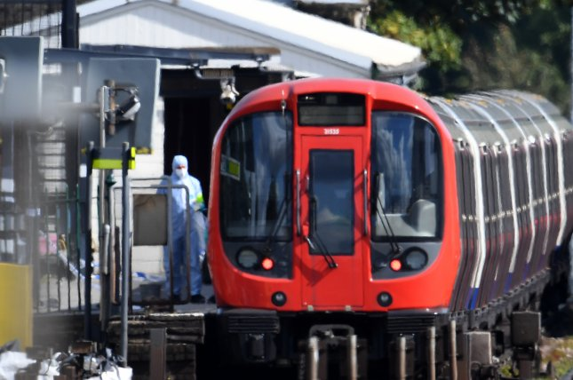 A forensics officer works at the scene of a terrorist bombing at a London commuter train on Sept. 15. London's police chief said Friday the bomb was designed to inflict maximum damage. Photo by Andy Rain/EPA-EFE