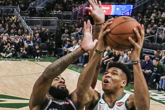 Milwaukee Bucks forward Giannis Antetokounmpo of Greece (R) scored a playoff career-high 41 points to help his squad sweep the Detroit Pistons out of the playoffs on Monday in Detroit. Photo by Tannen Maury/EPA-EFE