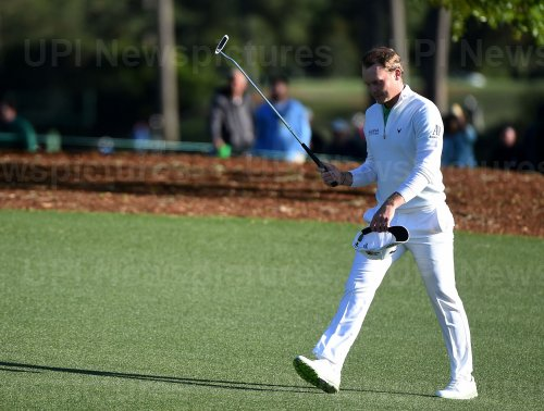 Danny Willett walks to the 18th green at the Masters