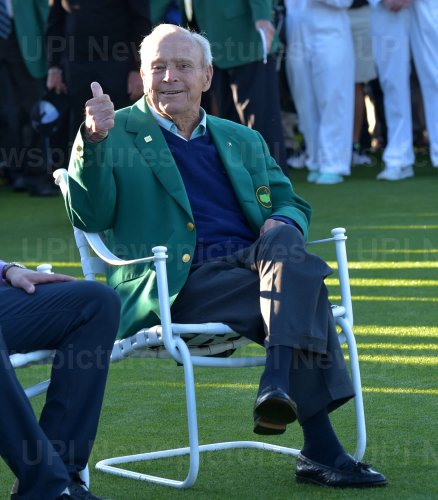 Honorary starter Arnold Palmer gives a thumbs at the Masters