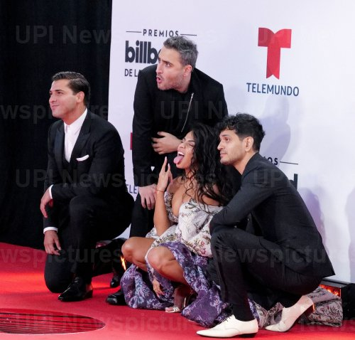 Jessie Reyez and Julio Ramírez Eguía, Jesús Navarro, Bibi Marín of Reik walk the red carpet at the 2020 Latin Billboard Awards in Sunrise, Florida
