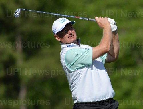 Ernie Els hits a tee shot at the Masters