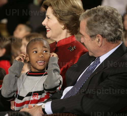President Bush and first lady Laura Bush attend a a children's holiday reception at the White House