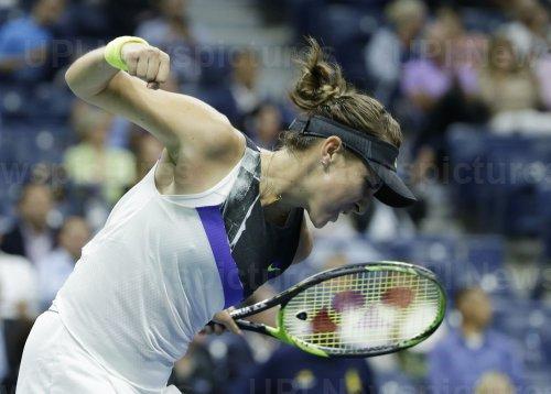 Belinda Bencic of Switzerland pumps her fist at the US Open