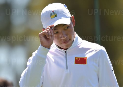 Jin Cheng of China tips his hat at the Masters