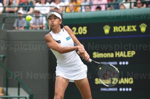 Zhang Shuai rerturns the ball in her match against Simona Halep
