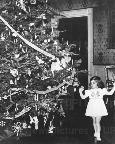 Five year old Caroline Kennedy admires Christmas tree at the White House in 1962
