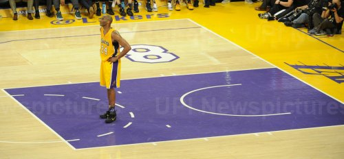 Los Angeles Lakers Kobe Bryant stand in the key in the second half in his final game