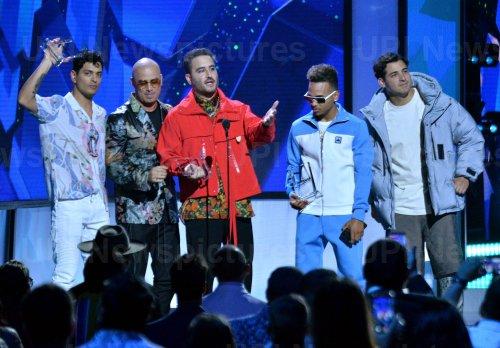 Gilberto Marin Espinoza, Wisin, Jesus Alberto Navarro Rosas, Ozuna and Julio Ramirez Eguia win award at the Billboard Latin Music Awards in Las Vegas