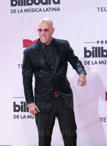 Kendo Kaponi walks the red carpet at the 2020 Latin Billboard Awards in Sunrise, Florida