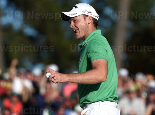 Danny Willett celebrates on the 18th green at the Masters