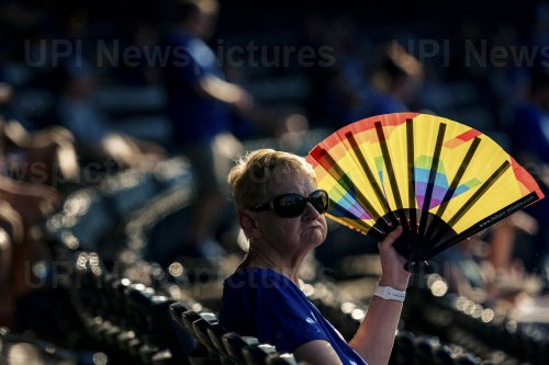 A Fan Blocks the Sun Before the Game