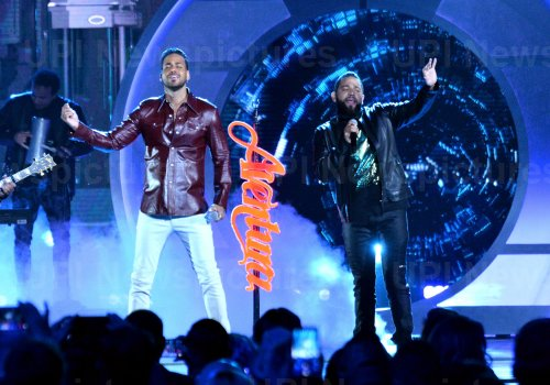 ROmeo Santos and Lenny Santos perform at the Billboard Latin Music Awards in Las Vegas