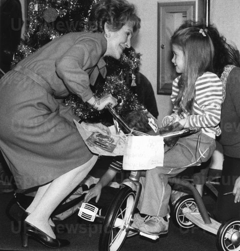 Nancy Reagan Talks to Child on Tricycle at Children's Hospital