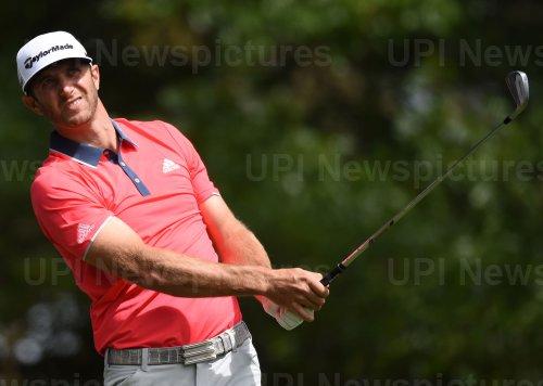 Dustin Johnson hits a tee shot at the Masters