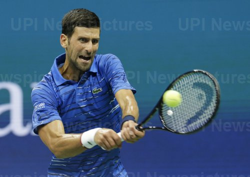 Novak Djokovic of Serbia hits a backhand at the US Open