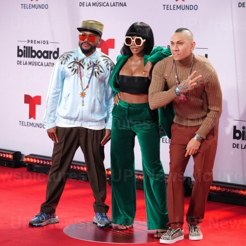 apl.de.ap, J. Rey Soul, and Taboo of the Black Eyed Peas walk the red carpet at the 2020 Latin Billboard Awards in Sunrise, Florida