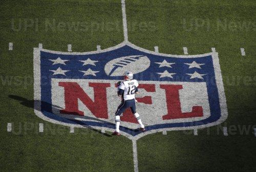 New England Patriots Tom Brady get gets set to throw a pass