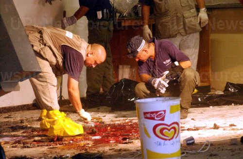 Israeli forensic police examine the blood on the floor of the cafeteria at Hebrew University