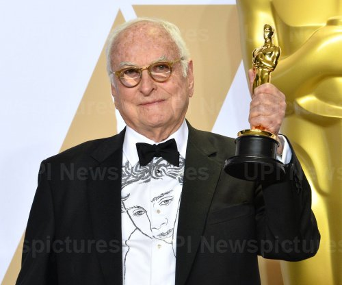 James Ivory wins Oscar for Best Adapted Screenplay at the 90th annual Academy Awards in Hollywood.