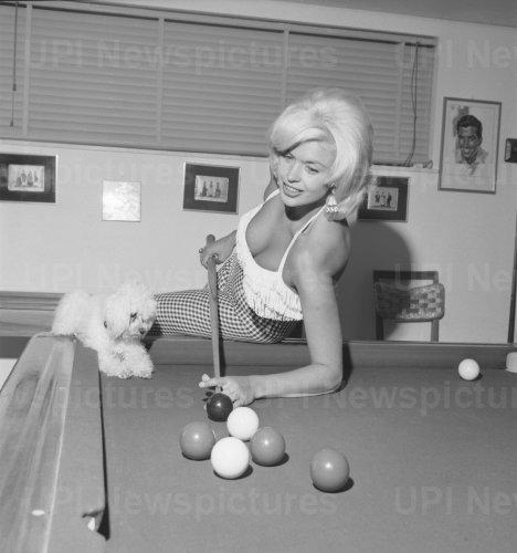 Jayne Mansfield plays pool in Rome