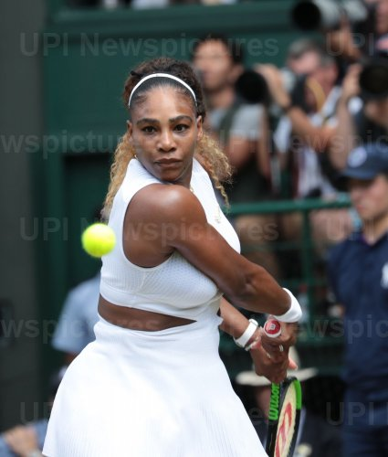 Serena Williams returns the ball in her Semi-Final match against Barbora Strycova