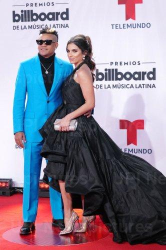 Randy Malcom of Gente De Zona walk the red carpet at the 2020 Latin Billboard Awards in Sunrise, Florida