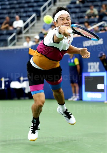 Kei Nishikori of Japan lunges for the ball at the US Open